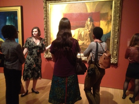 "Anna O. Marley, Curator of ""Henry Ossawa Tanner: Modern Spirit"" with Wellesley students in front of Tanner's ""Annunciation"""