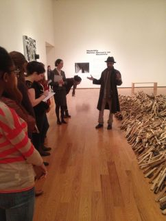 "Radcliffe Bailey talking to my class before the exhibition opening of ""Radcliffe Bailey: Memory As Medicine"" at the Davis Museum. Photo by Nikki A. Greene."