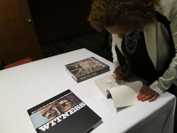 Dr. Jones signing a few of her books. Photo by Nikki A. Greene.