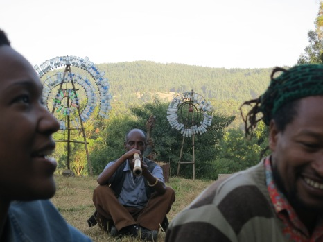 Nikki A. Greene, Daniel Alemayehu, & Tamrat Gezahegn. Work by Dawit Adnew. Netsa Art Village. Photo by Demissew Mersha.