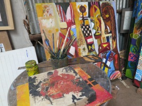 Netsa Art Village studio & storage space. Paintings by Tamrat Gezahegn. Photo by Nikki A. Greene.